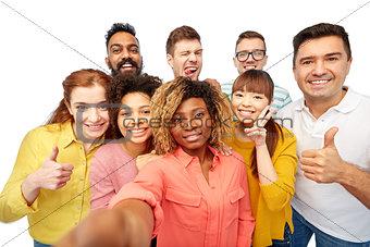 international group of happy people taking selfie