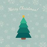 Christmas tree on winter backdrop.