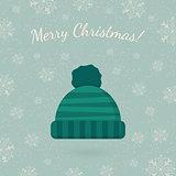 Winter hat on winter backdrop.