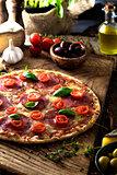 Fresh pizza on wood