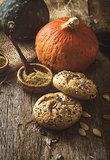 Pumpkin buns on wood