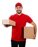 delivery service - young smiling courier holding boxes on white