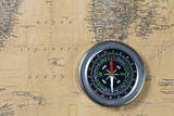 the Black compass on old vintage map, south atlantic ocean, macro background