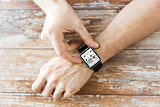 close up of hands with online shop on smart watch