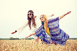 happy hippie women having fun on cereal field