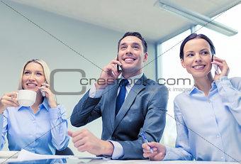 business team with smartphones having conversation