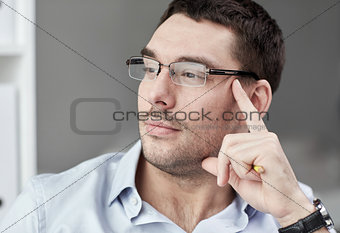portrait of businessman in eyeglasses at office