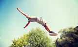 sporty young man jumping in summer park