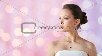 beautiful asian woman with earring and pendant