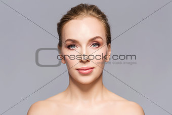 beautiful young woman face over gray background
