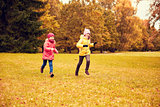 group of happy little girls running outdoors