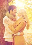 romantic couple kissing in the autumn park