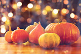 close up of halloween pumpkins on wooden table