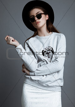 Beautiful fashion model with glasses and black hat