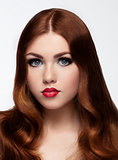 Ginger red long hair.Fashion portrait red lips