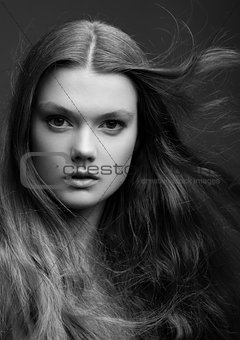 Portrait of beautiful young girl with long hair