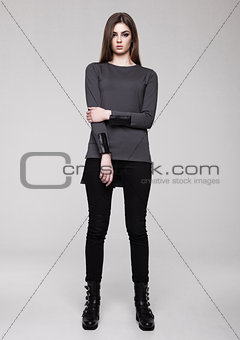 Beautiful young girl wearing shirt fashion on grey