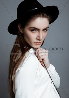 Beautiful fashion model in white with black hat