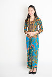 Southeast Asian woman in batik dress