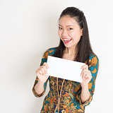 Southeast Asian female hand holding white paper card