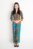 Southeast Asian girl in batik dress