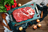 Fresh beef veal meat on rustic wooden table