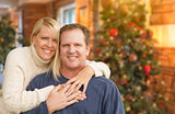 Loving Caucasian Couple Portrait In Front of Christmas Tree