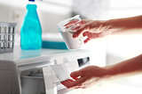 hands of woman that fills detergent