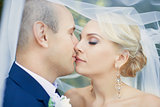 The bride kisses the groom gently
