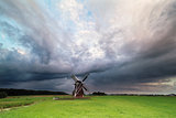 dark stormy clouds over windmill
