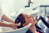 happy young woman at hair salon