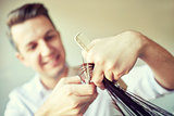 stylist with scissors cutting hair tips at salon