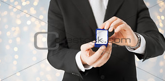 close up of man with engagement ring in gift box