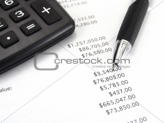 calculator and pen with balance sheet