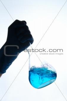 hand shaking chemical retort