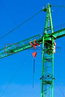 A tall worksite crane