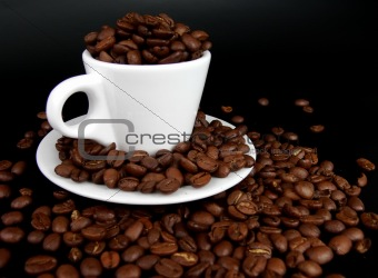 A coffee mug full of coffee beans