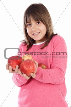 Adorable girl with red apples