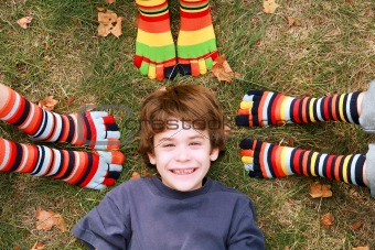 Boy Smiling Surrounded by Toe