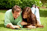 couple reading outdoors