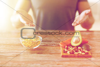 close up of male hands with food rich in protein