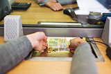 hands taking cash money at bank office
