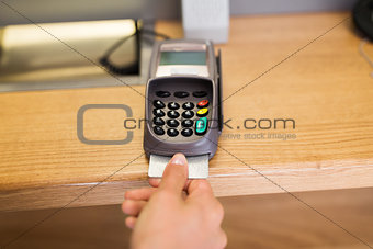 close up of hand inserting bank card to terminal