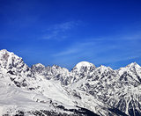 Snow mountains and blue sky in winter at sun day
