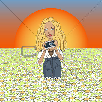 beautiful girl in jeans with a camera at sunset, photographing the flowers of chamomile.