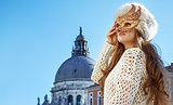 woman looking into the distance while wearing Venetian mask