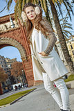 fashion-monger near Arc de Triomf in Barcelona looking aside