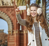 fashion-monger in Barcelona, Spain taking photo with cellphone