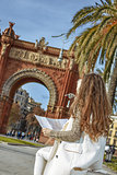 woman near Arc de Triomf in Barcelona, Spain looking at map