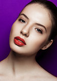 Beautiful woman with makeup red lips on purple background
